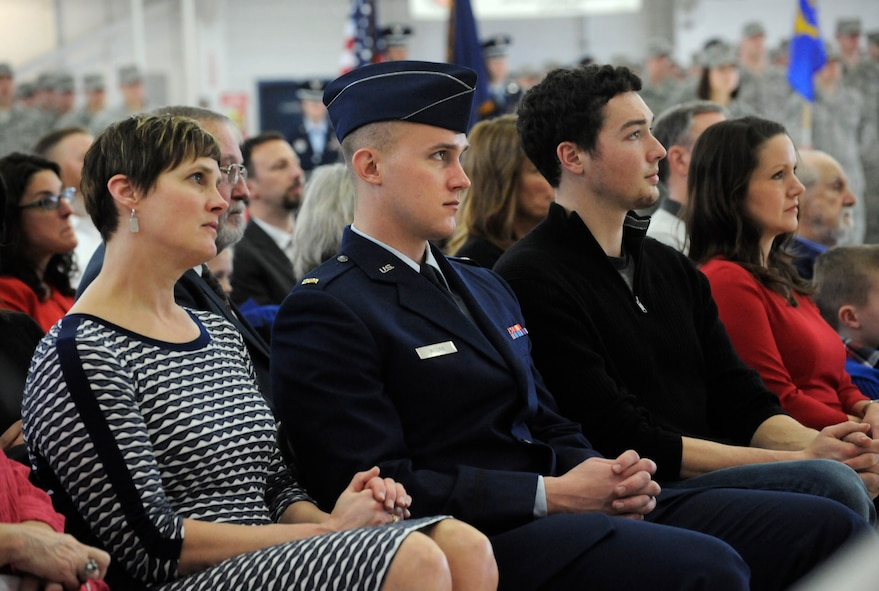 Family members of U.S. Air Force Col. Richard W. Wedan and U.S. Air Force Col. Paul T. Fitzgerald listen to remarks by members of the official party during the Change of Command ceremony held Feb. 7, 2015, Portland Air National Guard Base, Ore. (U.S. Air National Guard photo by Tech. Sgt. John Hughel, 142nd Fighter Wing Public Affairs)