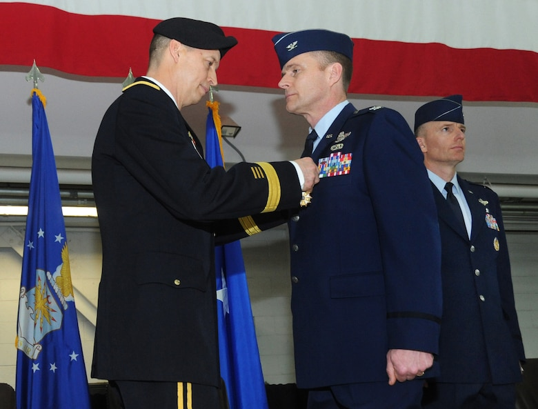 U.S. Air Force Col. Richard W. Wedan, outgoing commander 142nd Fighter Wing, right, is presented with The Legion of Merit Medal from Army Maj. Gen. Daniel R. Hokansen, The Adjutant General, Oregon, left, during the Change of Command ceremony for the 142nd Fighter Wing, Feb. 7, 2015, Portland Air National Guard Base, Ore. (U.S. Air National Guard photo by Tech. Sgt. John Hughel, 142nd Fighter Wing Public Affairs)