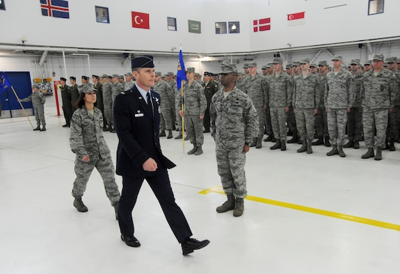 U.S. Air Force Col. Richard W. Wedan, outgoing commander 142nd Fighter Wing, right, along with The Adjutant of ceremony, 1st Lt. Amy Newkirk, assigned to the 142nd Fighter Wing Maintenance Group, left, perform a final inspection of the Airmen of the wing during the Change of Command ceremony held Feb. 7, 2015, Portland Air National Guard Base, Ore. (U.S. Air National Guard photo by Tech. Sgt. John Hughel, 142nd Fighter Wing Public Affairs)