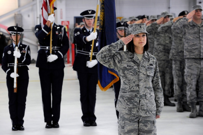 The Adjutant of ceremony, 1st Lt. Amy Newkirk, assigned to the 142nd Fighter Wing maintenance group, salutes the command during the Change of Command ceremony held Feb. 7, 2015, Portland Air National Guard Base, Ore. Col. Paul T. Fitzgerald assumed command of the wing as Col. Richard W. Wedan who retired after more than 27 years of service in the U.S. Air Force. (U.S. Air National Guard photo by Tech. Sgt. John Hughel, 142nd Fighter Wing Public Affairs)