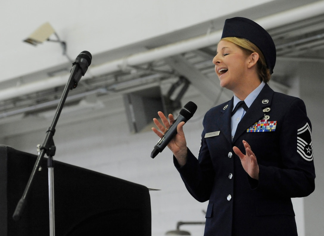 Senior Master Sgt. Denise Phillips, assigned to the 142nd Fighter Wing Mission Support Group, sings the National Anthem during the Change of Command ceremony held Feb. 7, 2015, Portland Air National Guard Base, Ore. Col. Paul T. Fitzgerald assumed command of the wing as Col. Richard W. Wedan retired after more than 27 years of service in the U.S. Air Force. (U.S. Air National Guard photo by Tech. Sgt. John Hughel, 142nd Fighter Wing Public Affairs)