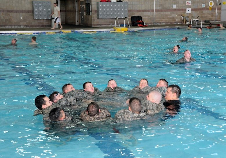 Airmen from the 138th Civil Engineering Squadron participated in a basic water survival course during their unit training assembly Feb. 8, 2015, at the Claremore Super Recreation Center, Claremore, Okla.     The goal of the training was to not only teach water survival skills, but also foster teamwork and build a sense of comradery among CES airmen. (U.S. National Guard photo by Tech. Sgt. Roberta A. Thompson/Released)