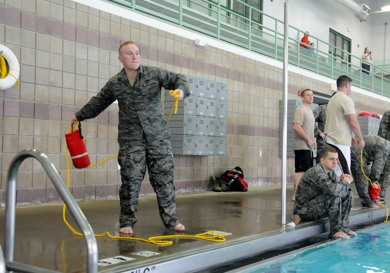 Senior Airman Patrick Delehanty assigned to the 138th Civil Engineering Squadron (CES), practices deploying a floatation device while participating in a basic water survival course during his unit training assembly Feb. 8, 2015, at the Claremore Super Recreation Center, Claremore, Okla.    The goal of the training was to not only teach water survival skills, but also foster teamwork and build a sense of comradery among CES airmen. (U.S. National Guard photo by Tech. Sgt. Roberta A. Thompson/Released)
