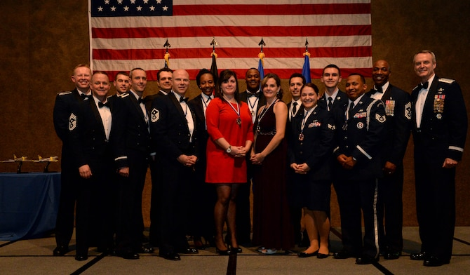 The 52nd Fighter Wing award winners pose with 3rd Air Force and 17th Expeditionary Force and 52nd FW leadership after the 52nd FW 2014 Annual Awards Banquet at the Skelton Memorial Fitness Center at Spangdahlem Air Base, Germany, Feb. 7, 2015. Thirteen out of 62 nominees earned awards in 13 different categories. (U.S. Air Force photo by Airman 1st Class Timothy Kim/Released)