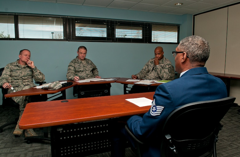 From left, Command Chief Master Sgt. Eric Wallace, Major Glenn Davis, and Senior Master Sgt. Ed Taylor, 121st Air Refueling Wing, interview Master Sgt. Earl Walker at Rickenbacker Air National Guard Base, Ohio, Feb. 7, 2015. Members of the 121st Air Refueling Wing participated in mock board interviews during the February UTA. (U.S. Air National Guard photo by Tech. Sgt, Zachary Wintgens/Released)
