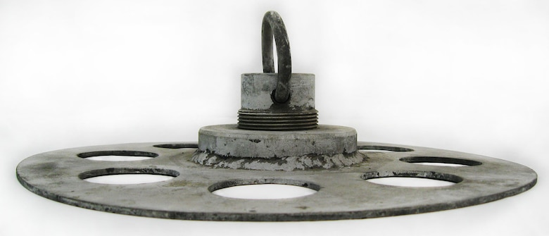 This item is a metal anchor plate that was developed to be the ground contact for an observation balloon attached to it by mooring lines. (U.S. Air Force photo)