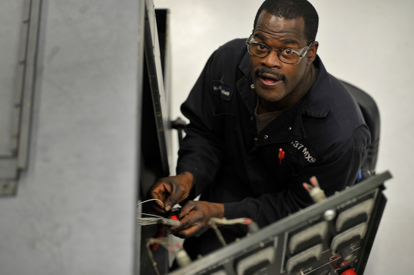 Paul Mansfield, an aerospace ground equipment technician with the 437th Maintenance Squadron, repairs electrical plugs on an essex generator at Joint Base Charleston, S.C., Feb. 9, 2015. The majority of the 437 MXS works around the clock to ensure mission success. (U.S. Air Force photo/Tech. Sgt. Renae Pittman)