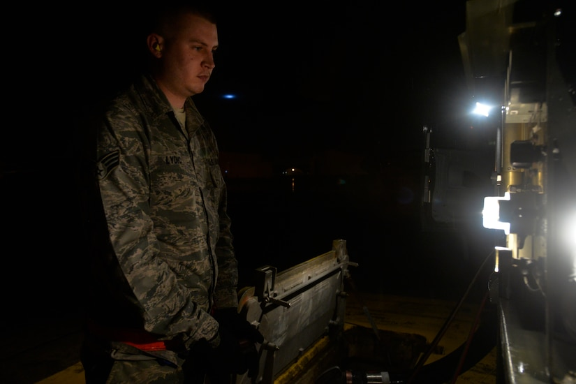 Senior Airman Eric Lydic, a fuels technician with the 628th Logistics Readiness Squadron, monitors pressure gauges during a refueling operation at Joint Base Charleston, S.C., Feb. 9, 2015. The fuels section is one of multiple units on base that work around the clock, no matter the weather, to ensure the mission accomplishment. (U.S. Air Force photo/Tech. Sgt. Renae Pittman)