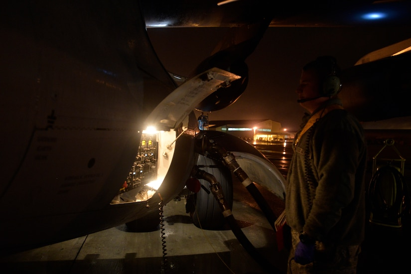 Senior Airman Zachary Elkins, a crew chief with the 437th Aircraft Maintenance Squadron, monitors the maintenance panel of a C-17 Globemaster III during refueling at Joint Base Charleston, S.C., Feb. 9, 2015. Elkins belongs to the gold aircraft maintenance unit and works the swing shift, from 3 p.m. to 11 p.m. (U.S. Air Force photo/Tech. Sgt. Renae Pittman)