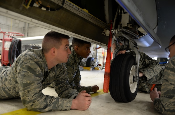 Airmen with the 372nd Training Squadron Detachment 21, inspect the landing gear of a RQ-4 Global Hawk Jan. 20, 2015, at Beale Air Force Base, Calif. The Airmen are the first students to attend the RQ-4 remotely piloted aircraft maintenance course taught at Beale. (U.S. Air Force photo by Senior Airman Bobby Cummings)