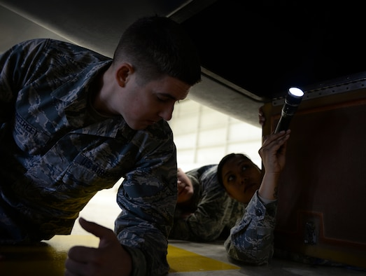 Tech. Sgt. Maureen Madamba (right), 372nd Training Squadron Detachment 21 maintenance instructor, inspects the interior of a RQ-4 Global Hawk with Airman Murray Hemstreet , 372nd TRS Detachment 21, student, Jan. 20, 2015, at Beale Air Force Base, Calif. Hemstreet is one of the first students to attend the RQ-4 remotely piloted aircraft maintenance course taught at Beale. (U.S. Air Force photo by Senior Airman Bobby Cummings)