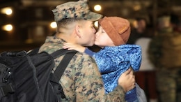 A Marine greets his son during a homecoming event aboard Camp Lejeune, N.C., Jan. 14, 2015. Marines and Sailors with Combat Logistics Battalion-2 returned from a six-month deployment in support of Special Purpose Marine Air-Ground Task Force Crisis Response-Africa.