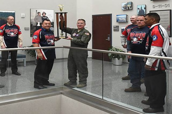 The NORAD-USNORTHCOM silver softball team presented their base championship trophy to Lt. Gen. Michael Dubie, deputy commander United States Northern Command, and vice commander, U.S. Element, North American Aerospace Defense Command here Feb. 2, 2015.
