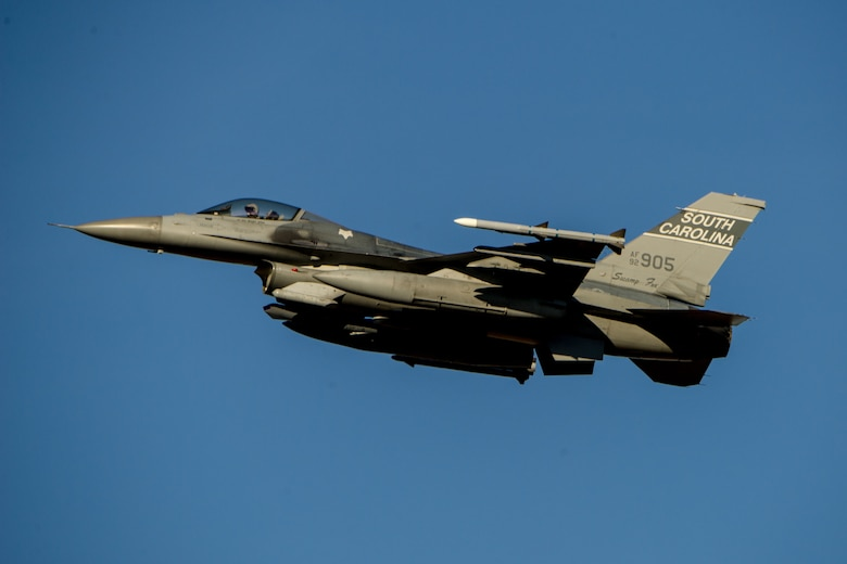 A U.S. Air Force F-16 Fighting Falcon Block 52, assigned to the 169th Fighter Wing, flies overhead during surge flying operations, Feb. 7, 2015, at McEntire Joint National Guard Base, S.C. The surge encompasses high tempo flying as part of vital training in preparation for deployments. (U.S. Air National Guard photo by Tech. Sgt. Jorge Intriago/Released)