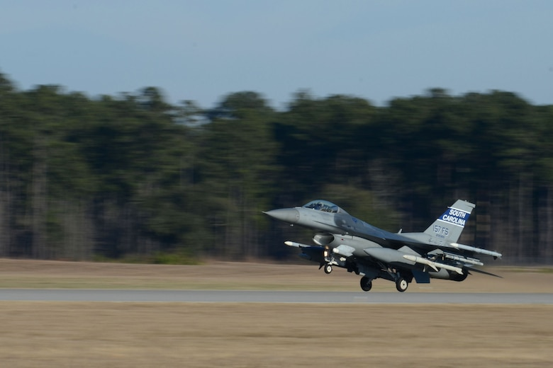 A South Carolina Air National Guard F-16 Fighting Falcon lands at McEntire Joint National Guard Base, after a training mission during surge flying operations Feb. 7, 2015. The surge encompasses high tempo flying as part of vital training in preparations for deployments. (U.S. Air National Guard photo by Amn Megan Floyd/Released)