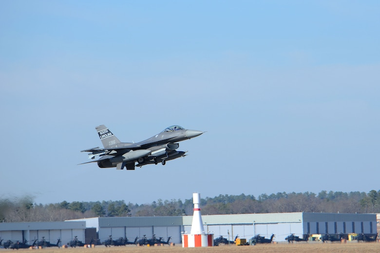 A U.S. Air Force fighter pilot, assigned to the 157th Fighter Squadron at McEntire Joint National Guard Base, South Carolina Air National Guard, launches an F-16 Fighting Falcon druing surge flying operations Feb. 7, 2015. The surge encompasses high tempo flying as part of vital training for deployments. (U.S. Air National Guard photo by Airman 1st Class Ashleigh S. Pavelek/Released)