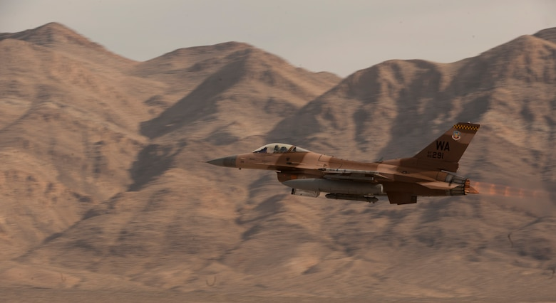 An F-16 Fighting Falcon assigned to the 64th Aggressor Squadron, takes to the sky as part of a Red Flag 15-1 training sortie from Nellis Air Force Base, Nev., Feb. 4, 2015. The 64th AGRS operates F-16s and F-15s in their role as an intelligent, adaptable adversary in support of various air combat exercises. (U.S. Air Force photo by Airman 1st Class Joshua Kleinholz)