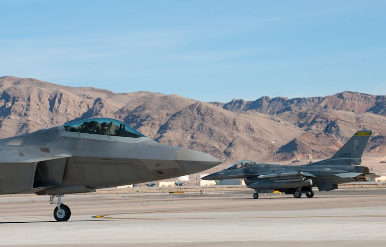 An F-22A Raptor assigned to the 94th Fighter Squadron, Joint Base Langley-Eustis, Va., taxis  out to the runway at the start of a Red Flag 15-1 training sortie  at Nellis Air Force Base, Nev., Feb. 2, 2015. Red Flag exercises bring joint and coalition air, space and cyber units together against a common adversary in order to further build tactical cohesion.  (U.S. Air Force photo by Airman 1st Class Joshua Kleinholz)