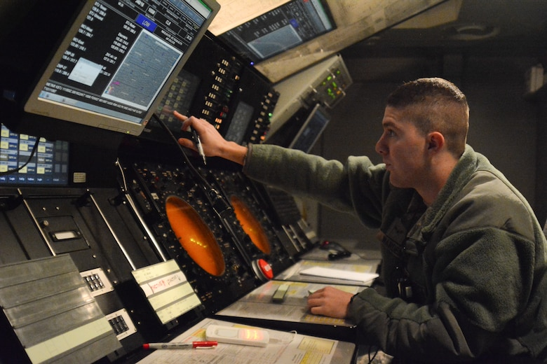 U.S. Air Force Airman 1st Class Alex Warden, an air traffic controller assigned to the 241st Air Traffic Control Squadron (ATCS), Missouri Air National Guard, monitors air traffic at Rosecrans Air National Guard Base, St. Joseph, Mo., Feb. 11, 2015. (U.S. Air National Guard photo by Tech. Sgt. Michael Crane/Released)
