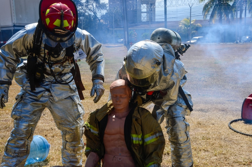 U.S. Air Force Staff Sgt. Christopher Harris and U.S. Air Force Senior Airman Collin Lorash, 612th Air Base Squadron firefighters, help remove a dummy from the area of a simulated chlorine spill during a hazardous material exercise on Soto Cano Air Base, Honduras, Feb. 10, 2015. The training exercise was held to guarantee members assigned to the 612th ABS Fire Department are compliant with the Department of Defense's requirement that all Air Force firefighters are certified to the hazmat technical level. (U.S. Air Force photo/Tech. Sgt. Heather Redman)