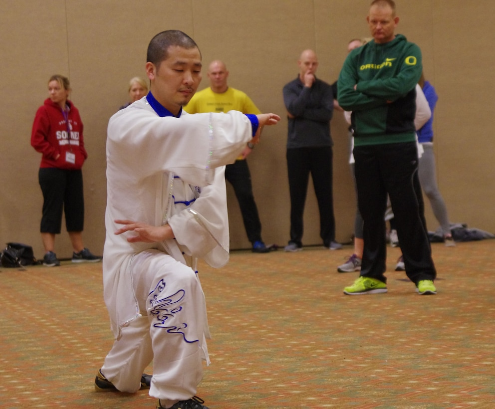 Tai Chi Master, Jian-Feng Chen, demonstrates various tai chi movements to Guardsmen and their families, helping them relax and decompress during the final day of a Yellow Ribbon Reintegration Program event in Bend Ore., Jan. 25, 2015. The Yellow Ribbon Reintegration Program provides deployment support and reintegration services to all service members, and their families, enabling them to sustain the rigors associated with deployment or mobilization.   (U.S. Air National Guard photos by Tech. Sgt. Aaron Perkins, 142nd Fighter Wing Public Affairs/Released)