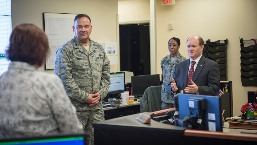 Sen. Chris Coons of Delaware learns about the Human Remains Command, Control and Communication mission Feb. 9, 2015, during a visit to Air Force Mortuary Affairs Operations, Dover Air Force Base, Del. The senator and his staff met with Airmen to learn more about operations at the Department of Defense's sole port mortuary. (U.S. Air Force photo by Capt. Ray Geoffroy)