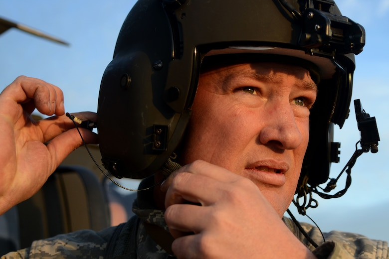 A U.S. Army National Guard soldier assigned to the 1st Battalion, 169th Aviation Regiment, Ft. Bragg, N.C., adjusts his flight helmet before takeoff at Poinsett Electronic Combat Range, Sumter, S.C., Feb. 6, 2015. While at Poinsett, soldiers practiced ground shooting on the M240 Machine Gun as well as day and night shooting from the air in a UH-60 Black Hawk. (U.S. Air Force photo by Airman 1st Class Michael Cossaboom/Released)