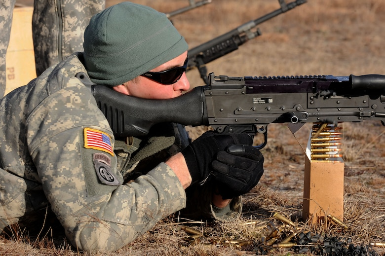 A U.S. Army National Guard soldier assigned to the 1st Battalion, 169th Aviation Regiment, Ft. Bragg, N.C., shoots an M240 machine gun at Poinsett Electronic Combat Range, Sumter, S.C., Feb. 6, 2015. Poinsett Range provides electronic warfare training, munition training, Tactical Air Control Party training, land navigation training, and survival, evasion, resistance, escape training. (U.S. Air Force photo by Airman 1st Class Michael Cossaboom/Released)