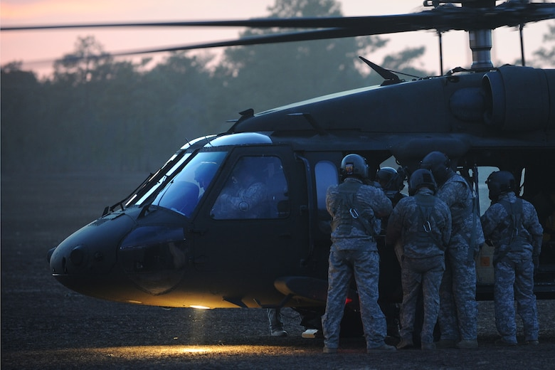 U.S. Army National Guard soldiers assigned to the 1st Battalion, 169th Aviation Regiment, Ft. Bragg, N.C., adjust a mounted M240 machine gun on a UH-60 Black Hawk at Poinsett Electronic Combat Range, Sumter, S.C., Feb. 6, 2015. In 2013, Poinsett had 754 aircraft use its range for training including the F-16CM Fighting Falcon, F-15E Strike Eagle, F/A-18 Super Hornet, UH-60 Black Hawk, and AH-64 Apache. (U.S. Air Force photo by Airman 1st Class Michael Cossaboom/Released)