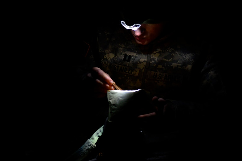 A U.S. Army National Guard soldier assigned to the 1st Battalion, 169th Aviation Regiment, Ft. Bragg, N.C., eats a meal-ready-to-eat at Poinsett Electronic Combat Range, Sumter, S.C., Feb. 6, 2015. The soldiers trained during the day as well as during the night to ensure they remain mission ready. (U.S. Air Force photo by Airman 1st Class Diana M. Cossaboom/Released)