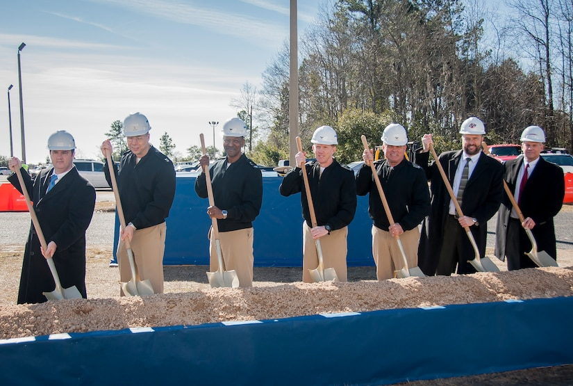 A groundbreaking ceremony for military construction projects P100/P099 was held Feb. 6, 2015 at Nuclear Power Training Unit Charleston at Joint Base Charleston – Weapons Station, S.C. Pictured (from left): Charles Friendly, Site Project Planning and Engineering manager, Master Chief Donald Ziegler, NPTU command master chief, CAPT Steve Hamer, Naval Facilities Engineering Command Southeast commanding officer, CAPT Robert Hudson, NPTU Charleston commanding officer, CAPT Timothy Sparks, JB Charleston deputy commander, J.H. Smyder, NPTU technical director and B.E. Stewart, Caddell Construction Co., Inc., president and CEO.  The NPTU building currently serves more than 1,400 students a year, and is expected to double to more than 3,000 students by 2020. The new facilities and simulation technology will enable NPTU's mission to successfully meet the future Fleet training demand. (U.S. Air Force photo / Senior Airman Tom Brading)