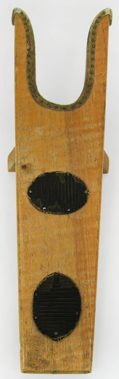 A boot jack is a tool used in the removal of boots.The boot heel is placed in the U-shaped opening of the boot jack, while the other foot is standing on the flat end of the boot jack, and then with a pull the foot is freed from the boot. Boot jacks help prevent stooping and struggling when removing tall riding boots that have been worn all day. And for sanitary purposes, they can keep hands clean of mud and manure while dirty riding boots are being removed. (U.S. Air Force photo)