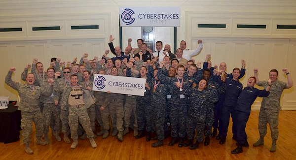 Sixty cadets and midshipmen from the service academies pose for a group photo during the second annual Defense Advanced Projects Research Agency's Service Academy CyberStakes Live event held at the Soldiers and Sailors Memorial Hall and Museum in Pittsburgh, Jan. 30 to Feb. 1, 2015. The decathlon-style computer-security competition pitted teams from each school head to head over three days to support the Defense Department's goal of integrating 6,000 cybersecurity experts into combat commands by 2016. DARPA photo