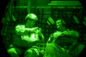 Staff Sgt. Eric McNair (left), a Survival Evasion Resistance and Escape specialist assigned to the 19th Operations Support Squadron, Little Rock Air Force Base, Ark., and Tech. Sgt. Dave Scarborough, 58th Rescue Squadron SERE specialist, prepare to perform a static line jump from a Royal Australian air force C-130J Super Hercules from 37 Squadron, Richmond, Australia, during Red Flag 15-1 over the Nevada Test and Training Range, Feb. 9, 2015. Red Flag provides the opportunity for U.S. and allied forces to train together for future real world conflicts where they may be required to work together. (U.S. Air Force photo by Senior Airman Thomas Spangler)