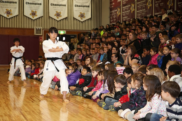 Dressed in their karate-gi, a Japanese karate training uniform, the Shunan International Children's Club demonstrates a sequence of traditional martial arts techniques during Matthew C. Perry Elementary School's Japanese Cultural Exchange aboard Marine Corps Air Station Iwakuni, Japan, Feb. 11, 2015. The 5th annual exchange included traditional martial arts, a classical Japanese dance and musical performances.
