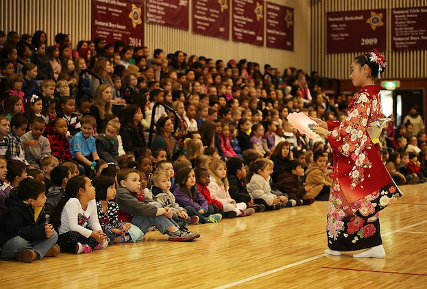 Children from Shunan International Children's Club perform the classical Japanese dance, Nihon-Buyo, during Matthew C. Perry Elementary School's Japanese Cultural Exchange aboard Marine Corps Air Station Iwakuni, Japan, Feb. 11, 2015. The 5th annual performance included traditional martial arts, a classical Japanese dance and musical performances. This ongoing cultural exchange illustrates the greater part of the U.S.-Japan relationship and solidifies ties with our host nation.