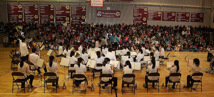 "The Shinnanyo High School Brass Band performs the ""Star-Spangled Banner"" for the staff and students of Matthew C. Perry Elementary School aboard Marine Corps Air Station Iwakuni, Japan, Feb. 11, 2015. M. C. Perry hosted their 5th annual Japanese Cultural Exchange Program at the school's gymnasium, which included traditional martial arts, a classical Japanese dance and musical performances."