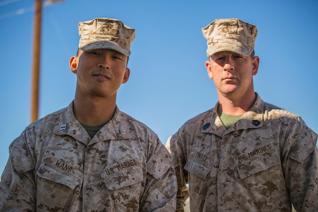 Gunnery Sgt. Kevin D. Pirtle (right) and Capt. Jim C. Wang pose for a photo Jan. 8 at Marine Air Ground Combat Center Twentynine Palms during Integrated Training Exercsie 2-15. Pirtle and Wang spend a lot of time working together in Headquarters and Service Company. Pirtle, a Somerville, Tennessee, native, is an infantry unit leader and the company gunnery sergeant, and Wang, a Fayetteville, North Carolina native, is an infantry officer and company commander, both with Headquarters and Service Company, 2nd Battalion, 3rd Marine Regiment, 3rd Marine Division, III Marine Expeditionary Force.