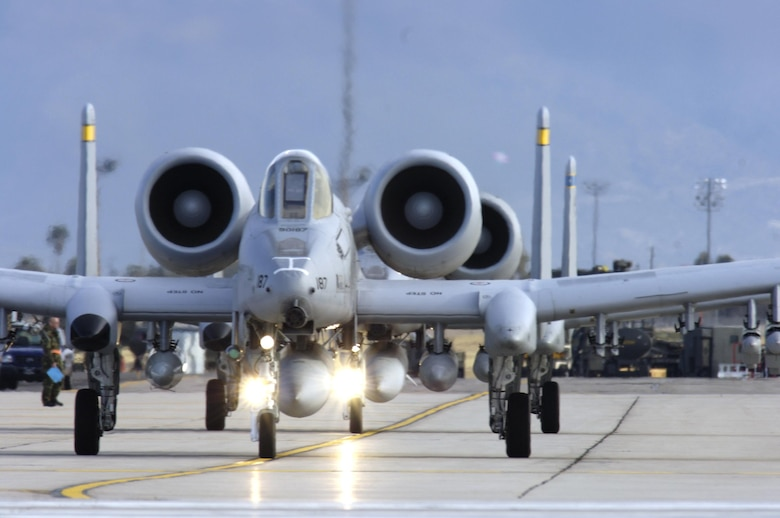 Pilots from the 354th Fighter Squadron taxi down the tarmac preparing to take off in their A-10 Thunderbolt IIs to a simulated deployed location as a part of exercise Bushwhacker 07-02 Jan. 21, 2007, at Davis-Monthan Air Force Base, Arizona. (U.S. Air Force photo/Senior Airman Jesse Shipps)
