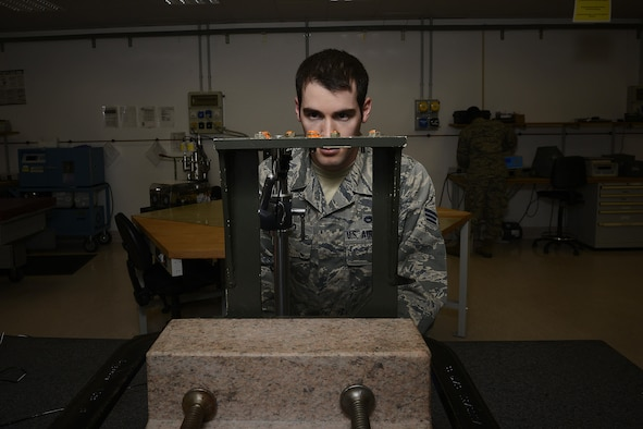 Senior Airman Evan Caso checks the setscrew height on a rate sensor unit boresight, Feb. 10, 2015, at Aviano Air Base, Italy. The precision measurement equipment laboratory (PMEL) Airmen support 5,200 different types of equipment on base for 84 different work centers.  Caso is a 31st Maintenance Squadron PMEL journeyman.  (U.S. Air Force photo/Airman 1st Class Ryan Conroy)