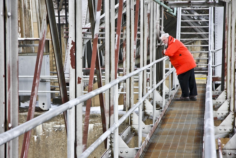Rich Lockwood, Operations and Regulatory Division chief, looks down on deteriorated lift gates from a catwalk along the Montgomery Locks and dam.