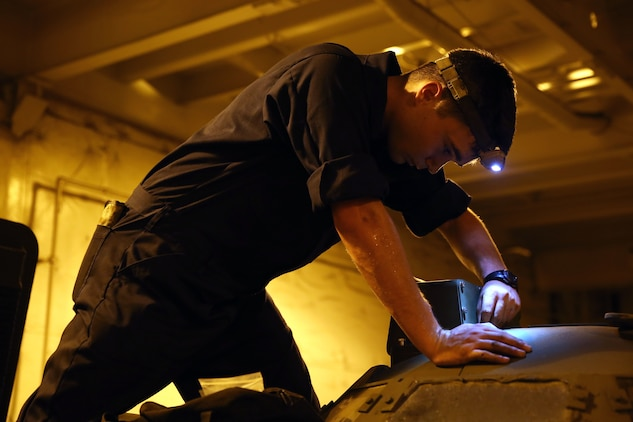 Cpl. Brock W. English with the Offload Preparation Party ensures all parts are operational on the Assault Amphibious Vehicles aboard the Maritime Prepositioning Force ship, USNS Pililaau, Feb. 6. The OPP Marines conducted pre-operation checks on all of the vehicles aboard the ship. Their mission is to prepare and offload the equipment from ship  to shore for use during Exercise Cobra Gold 2015. Cobra Gold is an annual Thailand /United States, co-sponsored multinational and joint theater security cooperation exercise, conducted in the Kingdom of Thailand. This year 25 nations are participating. English is an AAV crewman with General Support Platoon, and a Lampasas, Texas, native.