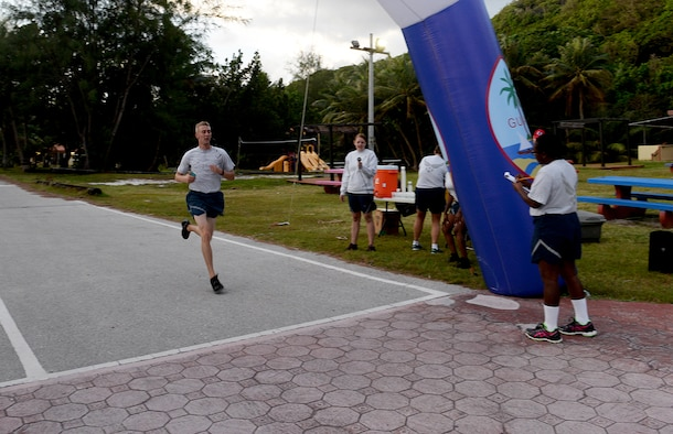 Staff Sgt. Jacob Johnson, 36th Munitions Squadron, passes the finish line during the I Love to Run 5K hosted by the Coral Reef Fitness Center Feb. 11, 2015, at Tarague Beach at Andresen Air Force Base, Guam. Johnson has placed first in five other 5Ks on Andersen (U.S. Air Force photo by Senior Airman Amanda Morris/Released.)