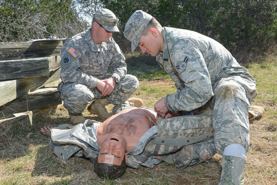 U.S. Air Force Airman 1st Class John Williams, 136th Maintenance Squadron, Texas Air National Guard, performs combat first aid on a combat-trauma mannequin during the 2015 Best Warrior Competition at Camp Swift, Texas, Feb. 7, 2015. The competition determines the best of the best warrior amongst Army and Air National Guardsmen. (photo by Master Sgt. Charles Hatton/released)