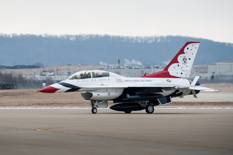 Maj. Scott Petz, a pilot with the U.S. Air Force Thunderbirds aerial demonstration squadron, taxies his F-16 Fighting Falcon to a parking spot at the Kentucky Air National Guard Base in Louisville, Ky., Feb. 12, 2015. Petz was in Louisville to coordinate logistics for the Thunderbirds team, which will be the marquee attraction at this year's Thunder Over Louisville air show April 18. (U.S. Air National Guard photo by Maj. Dale Greer)