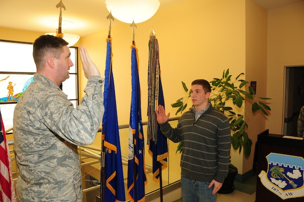 Airman 1st Class Luke Moyer raised his right hand and swore in to the 107th Airlift Wing New York Air National Guard here today.  He is the fifth in his family to carry on the military tradition. Feb. 12, 2015 (U.S. Air National Guard Photo/ Senior Master Sgt. Ray Lloyd)