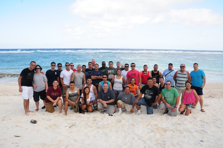 U.S. Air National Guard members from the 146th Airlift Wing Civil Engineering Squadron pose for a picture at Tarague Beach, Andersen Air Force Base Guam on February 11, 2015. The Airmen held a barbeque to celebrate the end of a successful TDY before departing back home. (U.S. Air National Guard photo by Airman 1st Class Madeleine Richards/Released)