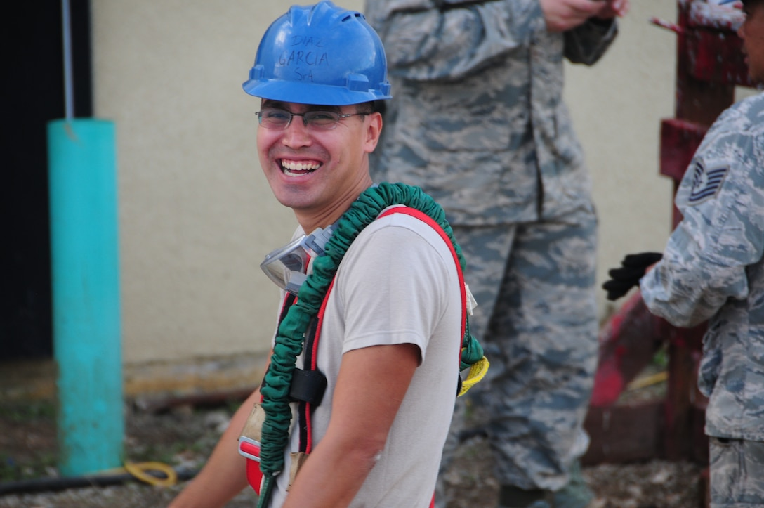 U.S. Air National Guard Senior Airman Guillermo Diaz-Garcia from the 146th Airlift Wing Civil Engineering Squadron works while on TDY in Guam at Andersen Air Force Base on February 9, 2015. (U.S. Air National Guard photo by Airman 1st Class Madeleine Richards/Released)