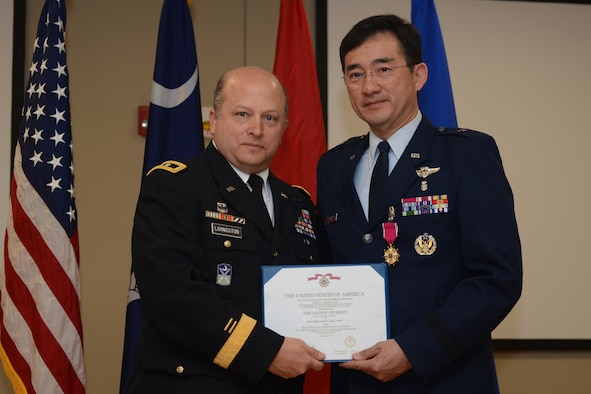 U.S. Army Maj. Gen. Robert E. Livingston Jr (left), the Adjutant General for South Carolina, presents the U.S. Air Force Legion of Merit to U.S. Air Force Brig. Gen. (Dr.) Jim Chow, the State Air Surgeon and Assistant to the Director of the Air National Guard, at McEntire Joint National Guard Base, Feb. 8, 2015. Brig. Gen. Chow retired with thirty years of service to the South Carolina Air National Guard and the 169th Fighter Wing. (U.S. Air National Guard photo by Senior Master Sgt. Edward Snyder/Released)