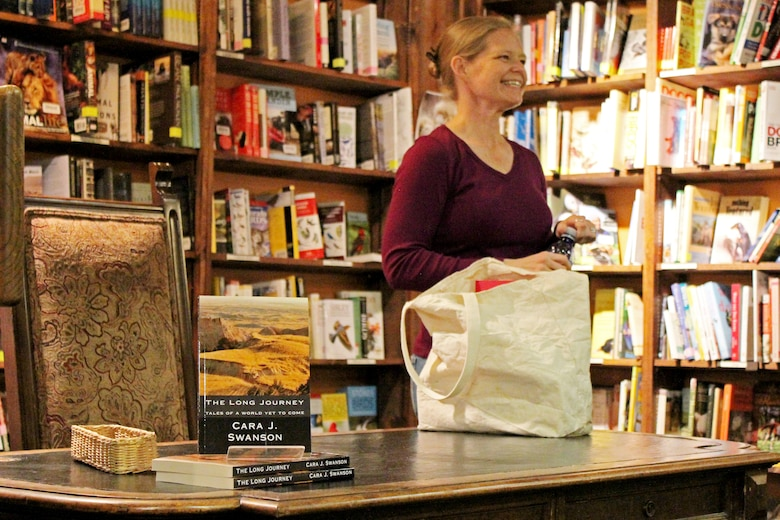 Capt. Cara J. Swanson, an Individual Mobilization Augmentee assigned to the 566th Intelligence Squadron, discusses her recently published novel, The Long Journey, Tales from a World Yet to Come, at Denver-area bookstore, the Tattered Cover, Jan. 27. The science fiction novel won second place in the 2014 Kindle Awards Best Fiction category.
